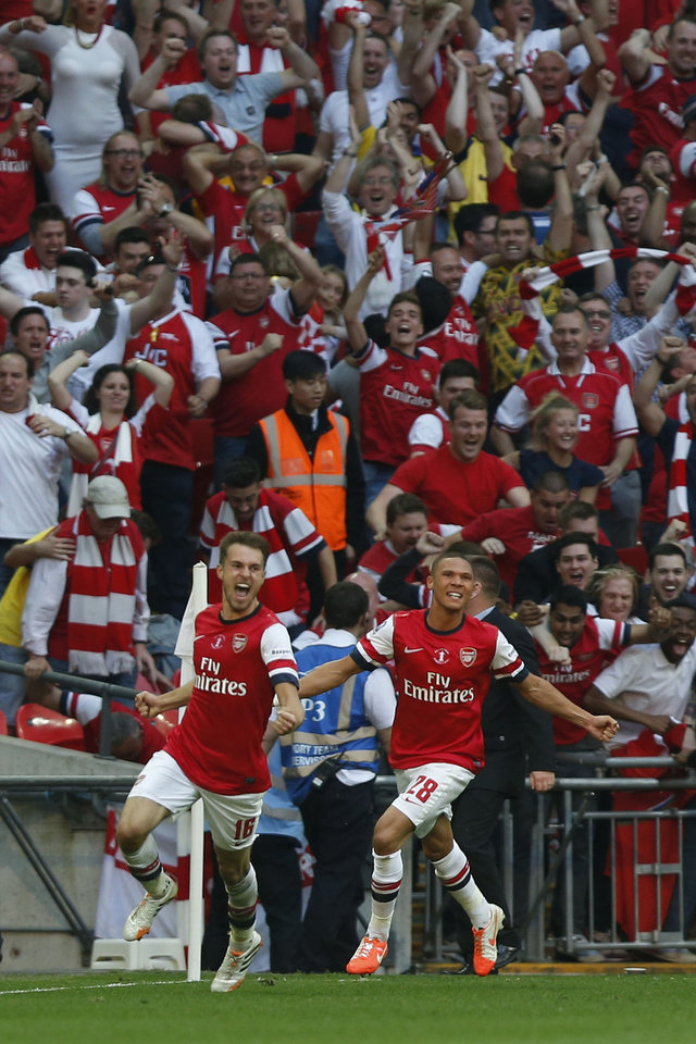Photo - Arsenal's Aaron Ramsey, left, celebrates his goal against Hull City with teammate Kieran Gibbs during their English FA Cup final soccer match at Wembley Stadium in London, Saturday, May 17, 2014. (AP Photo/Sang Tan)