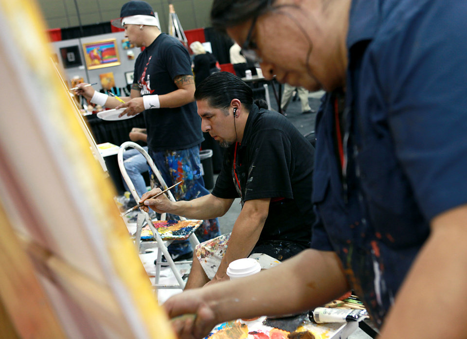 Photo - Artists Marwin Begaye, (right) Brent Greenwood (center) and Bunky Echo-Hawk (background) work on paintings during the Creativity World Forum at the Cox Convention Center in downtown Oklahoma City on Tuesday, Nov. 16, 2010. Photo by John Clanton, The Oklahoman