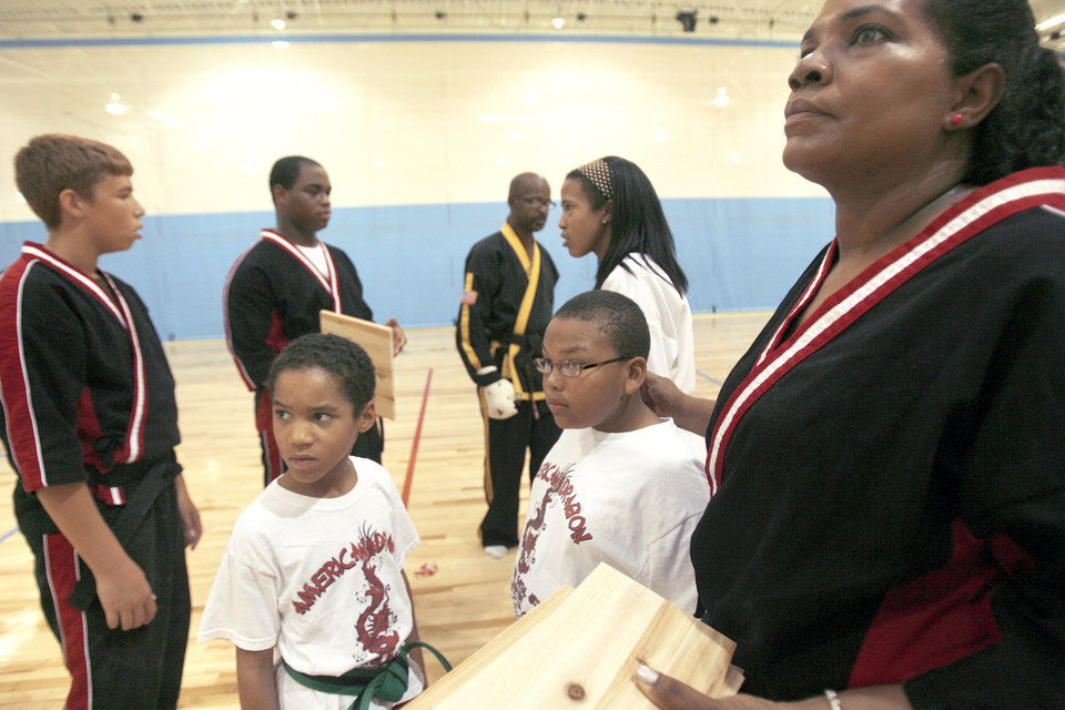 Photo - The karate class at the Memorial Park Boys & Girls Club on N Western Avenue in Oklahoma City gathers to break some wooden boards.  PHOTO BY ASHLEY MCKEE, THE OKLAHOMAN