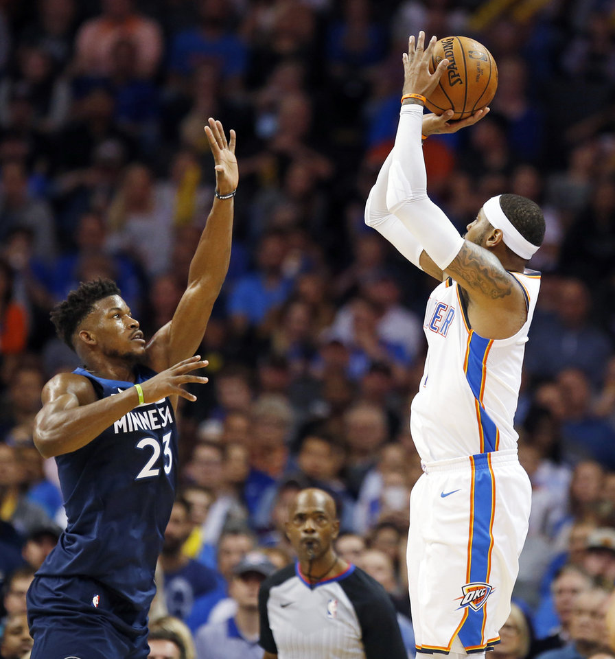 Photo - Oklahoma City's Carmelo Anthony (7) shoots against Minnesota's Jimmy Butler (23) during an NBA basketball game between the Oklahoma City Thunder and the Minnesota Timberwolves at Chesapeake Energy Arena in Oklahoma City, Sunday, Oct. 22, 2017. Minnesota won 115-113. Photo by Nate Billings, The Oklahoman