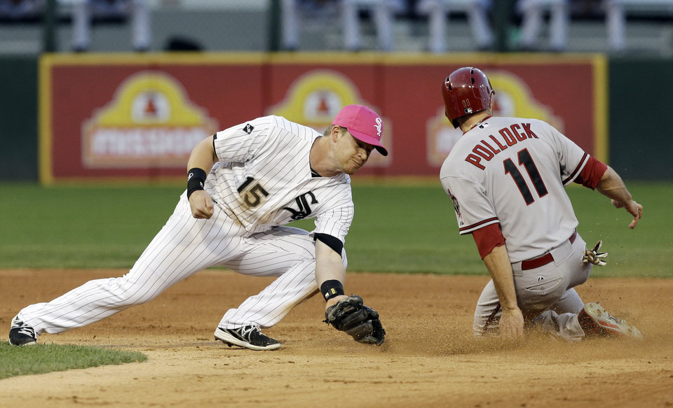 Photo - Arizona Diamondbacks' A.J. Pollock, right, steals second base as Chicago White Sox second baseman Gordon Beckham applies a late tag during the fifth inning of an interleague baseball game in Chicago, Saturday, May 10, 2014. (AP Photo/Nam Y. Huh)