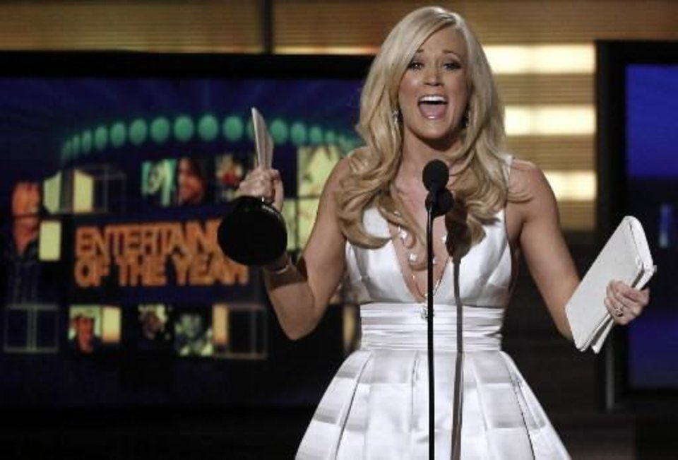 Carrie  Underwood accepts the award for Entertainer of the Year at the 45th Annual Academy of Country Music Awards in Las Vegas on Sunday, April 18, 2010. AP Photo