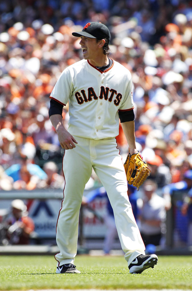 Photo - San Francisco pitcher Tim Lincecum reacts after finishing the fifth inning of a  baseball game against the Chicago Cubs, Wednesday, May 28, 2014, in San Francisco. (AP Photo/George Nikitin)