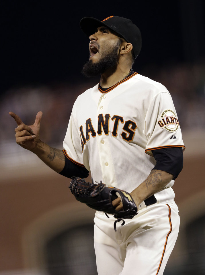 Photo -   San Francisco Giants reliever Sergio Romo celebrates after retiring the side during the ninth inning of a baseball game against the Arizona Diamondbacks on, Tuesday, Sept. 4, 2012 in San Francisco. (AP Photo/Marcio Jose Sanchez)