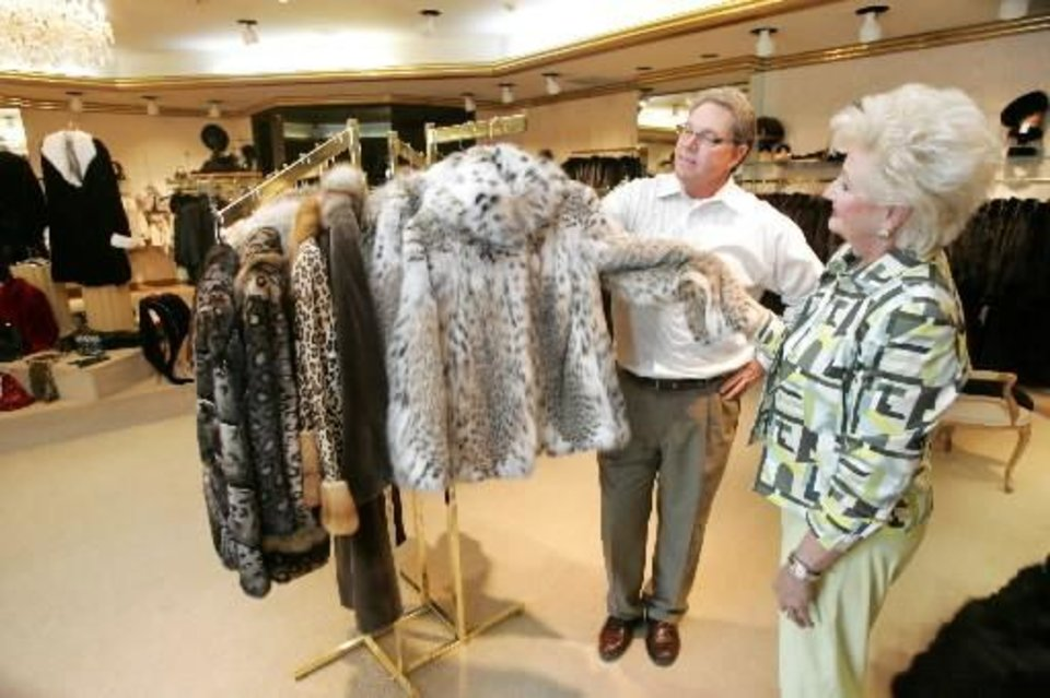 Photo - Koslow's manager  Steve  Daggs and fur consultant Phyllis K. Busch look at fur coat in Oklahoma City, Oklahoma August 18, 2009. Photo by  Steve Gooch, The Oklahoman