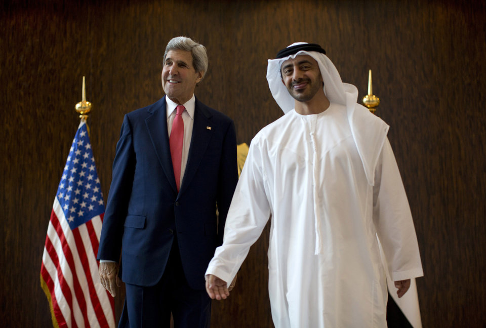 Photo - U.S. Secretary of State John Kerry, left, and United Arab Emirates Foreign Minister Abdullah bin Zayed Al-Nahyan pose for photographers at the foreign ministry in Abu Dhabi, Monday, Nov. 11, 2013.  (AP Photo/Jason Reed, Pool)