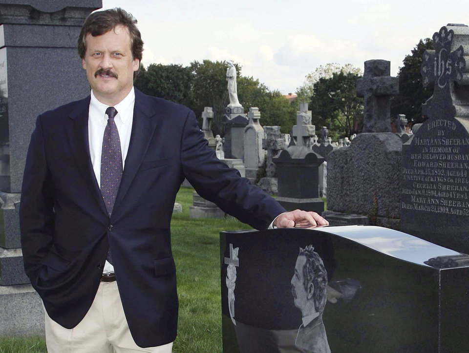 FILE - In this Oct. 1, 2006 file photo, author William B. Styple poses next to the grave of Civil War artist-writer James Edward Kelly at a cemetery in New York. Styple's latest book,