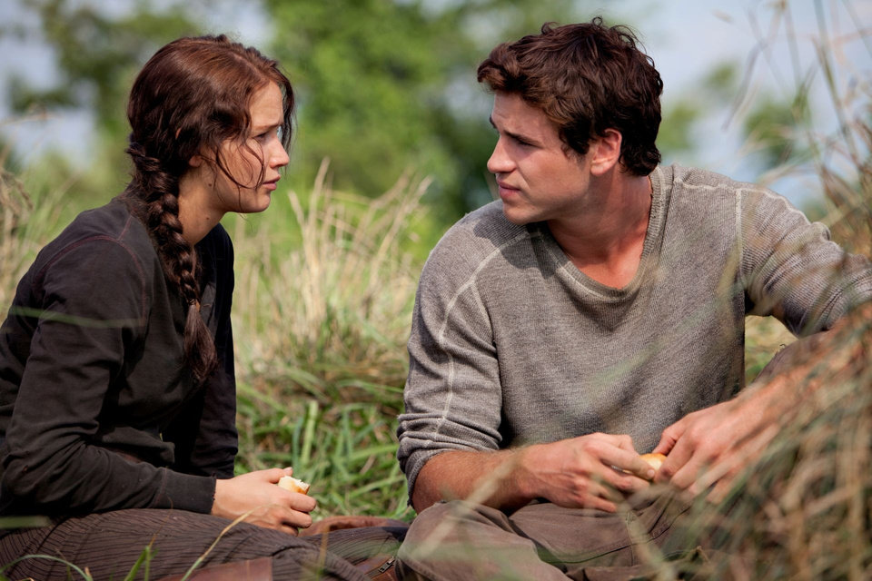 Katniss Everdeen (Jennifer Lawrence) and Gale Hawthorne (Liam Hemsworth) in