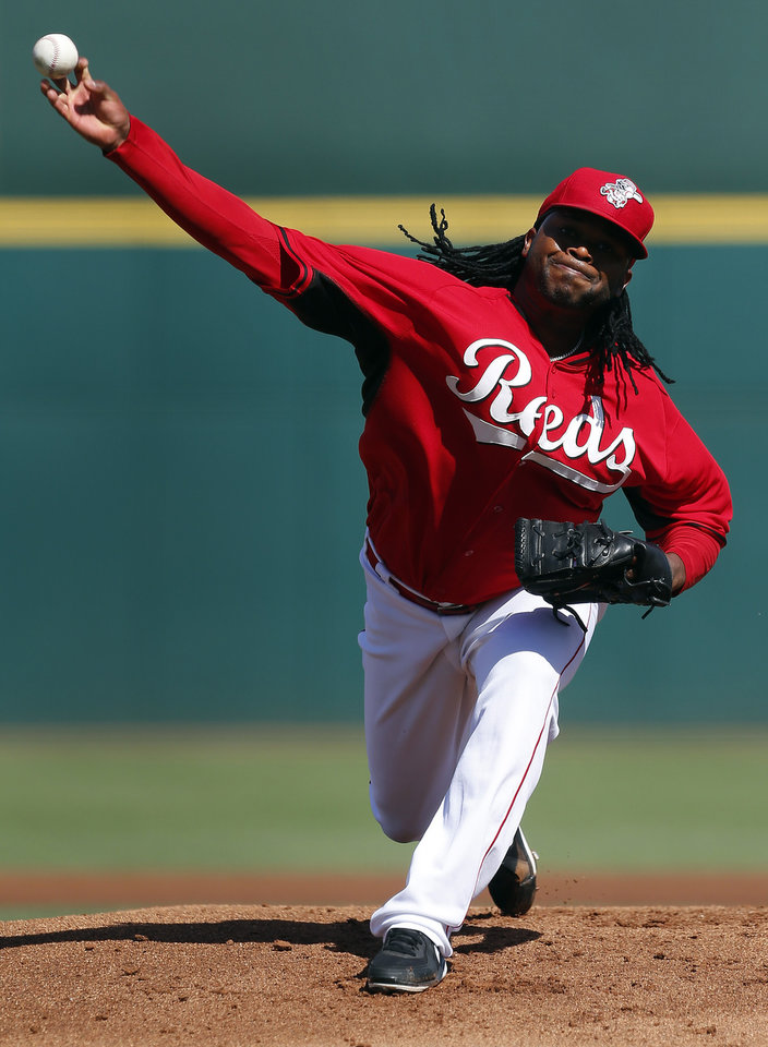 Photo - Cincinnati Reds pitcher Johnny Cueto throws against the Cleveland Indians in the first inning of during an exhibition baseball game in Goodyear, Ariz., Thursday, Feb. 27, 2014. (AP Photo/Paul Sancya)