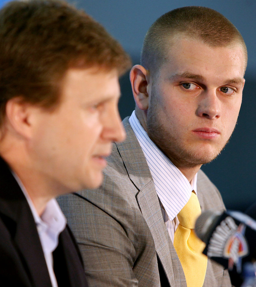 Photo - Cole Aldrich looks on as Scott Brooks talks with the media during a press conference at the Thunder Practice facility in Oklahoma City on Monday, July 12, 2010. Photo by John Clanton, The Oklahoman ORG XMIT: KOD