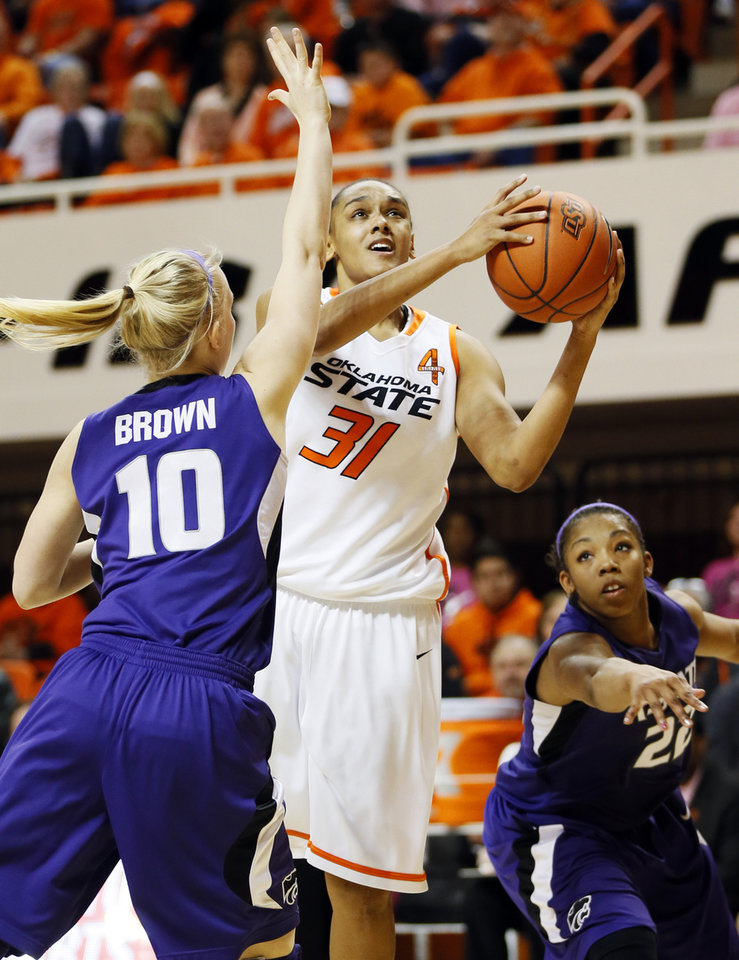 Photo - Oklahoma State's Kendra Suttles (31) takes a shot between Kansas State's Heidi Brown (10) and Mariah White (22) during an NCAA women's basketball game between Oklahoma State University (OSU) and Kansas State at Gallagher-Iba Arena in Stillwater, Okla., Saturday, Feb. 16, 2013. Photo by Nate Billings, The Oklahoman