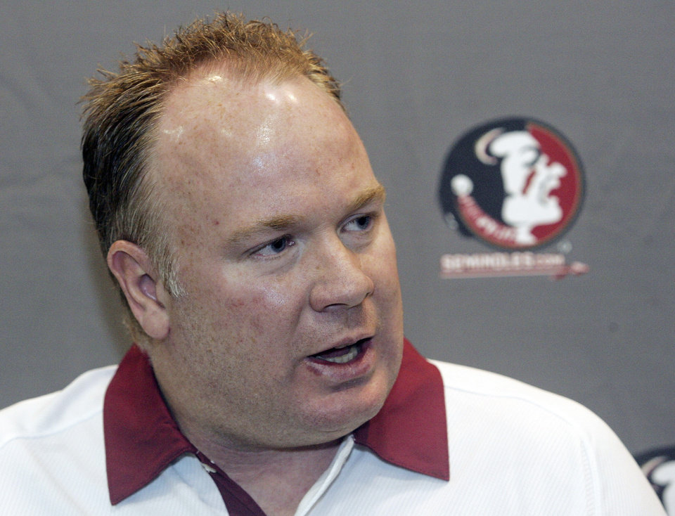 FILE - In this Aug. 12, 2012, file photo, Florida State defensive coordinator Mark Stoops is interviewed during the Seminoles\' football media day in Tallahassee, Fla. Kentucky has hired Florida State defensive coordinator Mark Stoops as its new football coach. The university announced Tuesday, Nov. 27, 2012 that Stoops will replace Joker Phillips, who was fired on Nov. 4. (AP Photo/Phil Sears, File) ORG XMIT: NY162