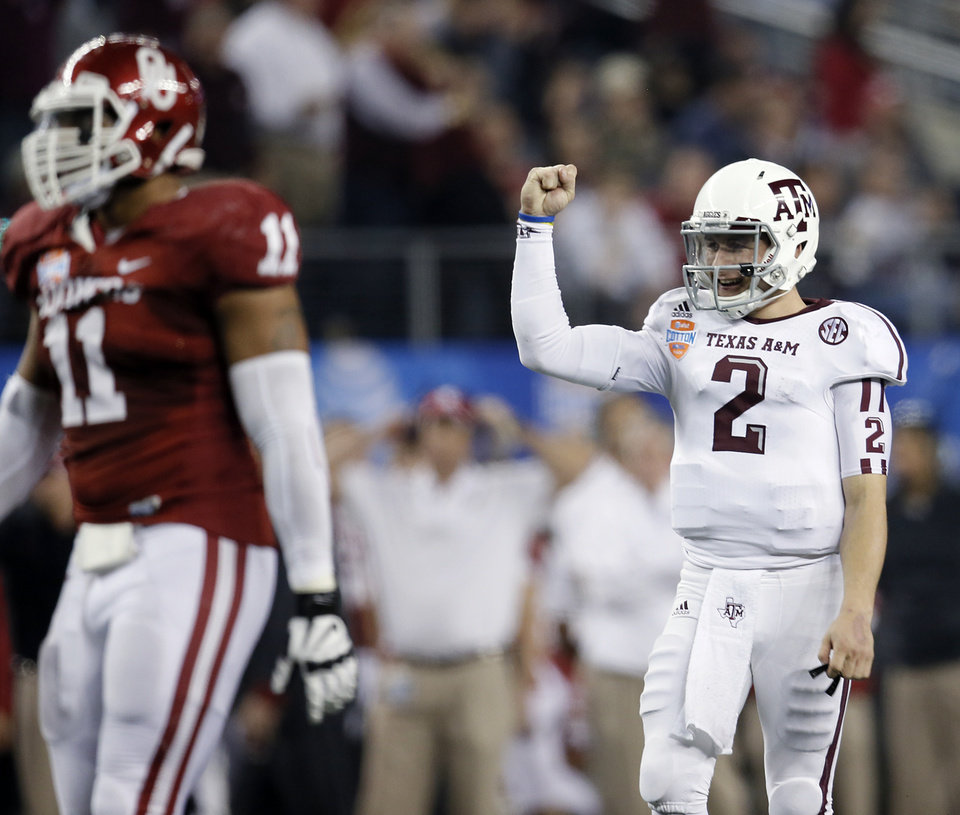 Photo - Texas A&M's Johnny Manziel (2) reacts after a touchdown during the college football Cotton Bowl game between the University of Oklahoma Sooners (OU) and Texas A&M University Aggies (TXAM) at Cowboy's Stadium on Friday Jan. 4, 2013, in Arlington, Tx. Photo by Chris Landsberger, The Oklahoman