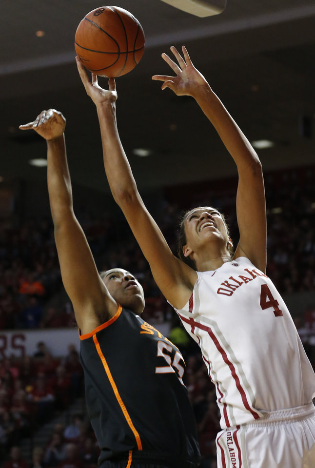 Photo - Oklahoma State's Liz Donohoe (4) shoots as Oklahoma State's LaShawn Jones (55) defends during the women's Bedlam basketball game between Oklahoma State University and Oklahoma at the Lloyd Noble Center in Norman, Okla., Sunday, Feb. 10, 2013.Photo by Sarah Phipps, The Oklahoman