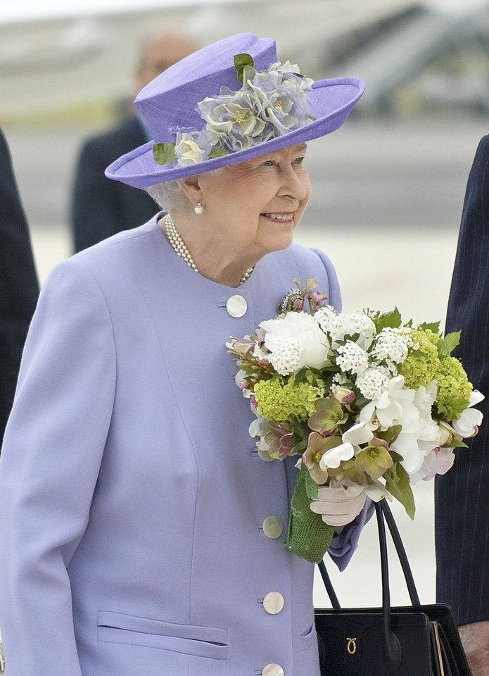 Photo - Queen Elizabeth II arrives at Rome's Ciampino military airport to start a one-day visit to Italy and the Vatican, Thursday, April 3, 2014. The British Royals will meet Italian President Giorgio Napolitano during an official lunch at the Quirinale Presidential Palace and Pope Francis at the Vatican in the afternoon. (AP Photo/Daniele Leone) Photo LaPresse 04-03-2014 Rome (Italy) News Queen Elizabeth and Prince Philip arrive at Ciampino airport