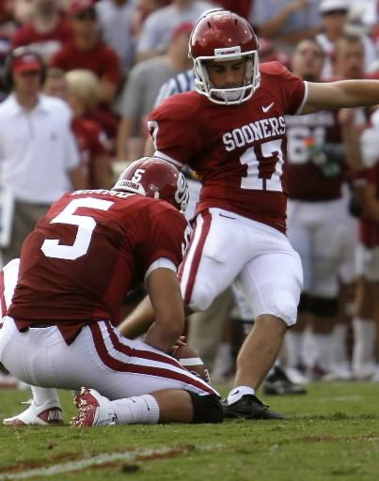 Photo - Oklahoma's Jimmy Stevens (17) kicks a field goal during the first half of the college football game between the University of Oklahoma Sooners (OU) and the Air Force Falcons at the Gaylord Family - Memorial Stadium on Saturday, Sept. 18, 2010, in Norman, Okla. Photo by Chris Landsberger, The Oklahoman