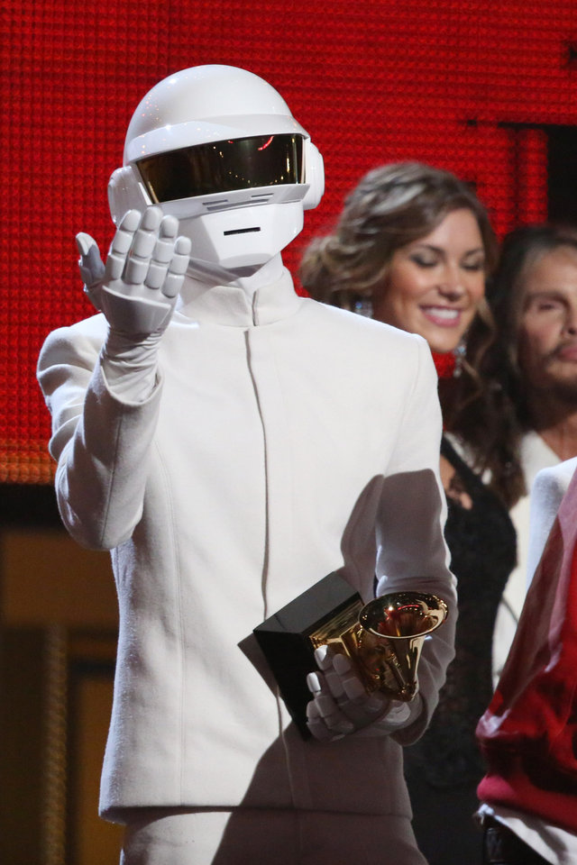 Photo - Thomas Bangalter, of Daft Punk, accepts the award for record of the year for
