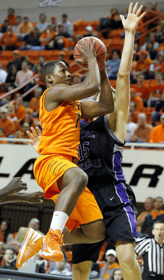 Oklahoma State\'s Le\'Bryan Nash (2) shoots as Central Arkansas\' Jordan Harks (15) defends during the men\'s college basketball game between Oklahoma State University and Central Arkansas at Gallagher-Iba Arena in Stillwater, Okla., Sunday,Dec. 16, 2012. Photo by Sarah Phipps, The Oklahoman