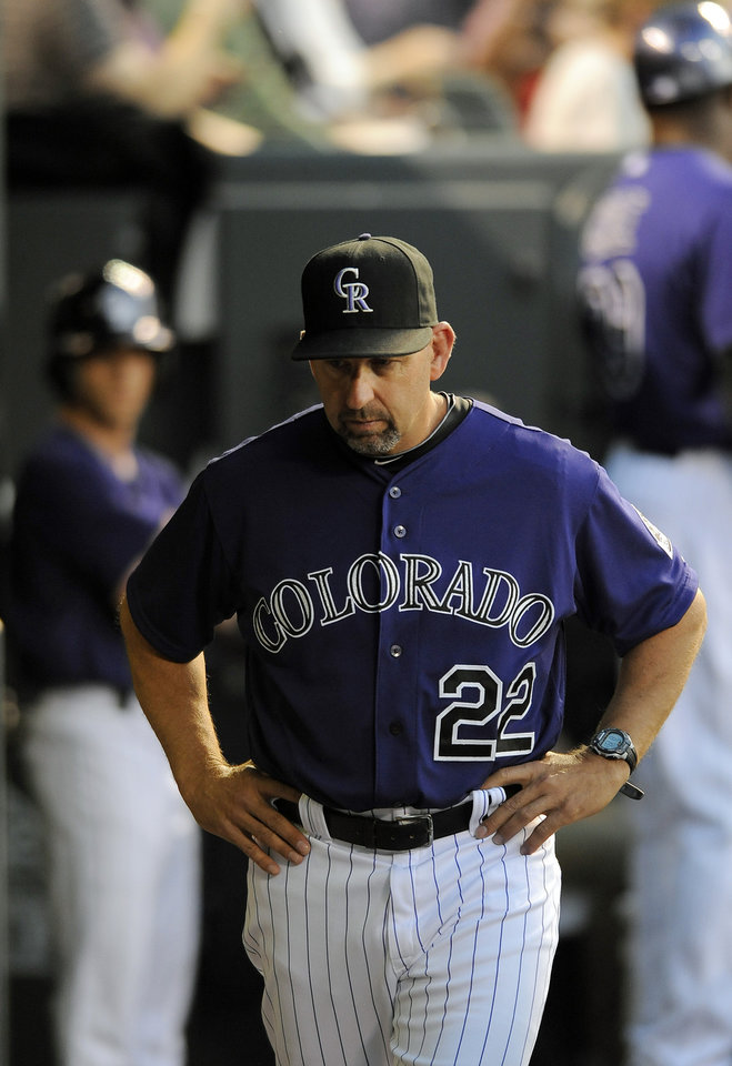 Photo - Colorado Rockies manager Walt Weiss stands in the dugout in the fourth inning of a baseball game against the Atlanta Braves on Monday, June 9, 2014, in Denver. (AP Photo/Chris Schneider)