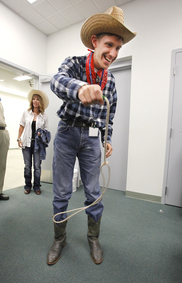 Zach Resavy tries twirling a rope during a Dale Rogers Center party.