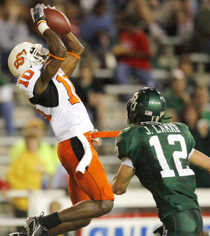 Photo - OSU's Tommy Devereaux (10) catches a touchdown pass over Baylor's Jake La Mar (12) in the first half during the college football game between Oklahoma State University and Baylor University at Floyd Casey Stadium in Waco, Texas, Saturday, Nov. 17, 2007. BY MATT STRASEN, THE OKLAHOMAN
