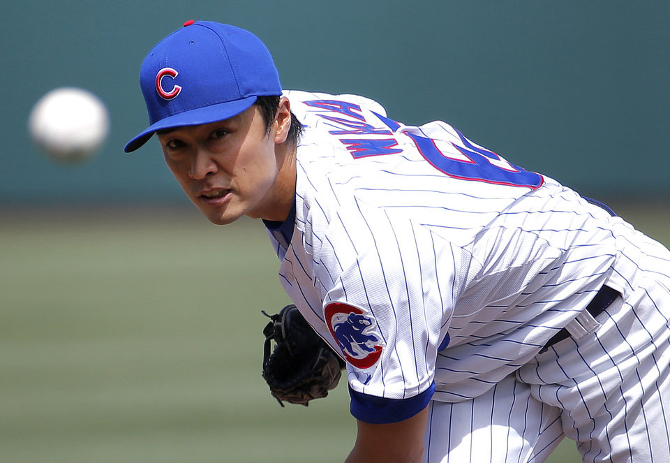 Photo - Chicago Cubs pitcher Tsuyoshi Wada, of Japan, throws against the Los Angeles Angels during the first inning of a spring training baseball game, Tuesday, March 25, 2014, in Mesa, Ariz. (AP Photo/Matt York)