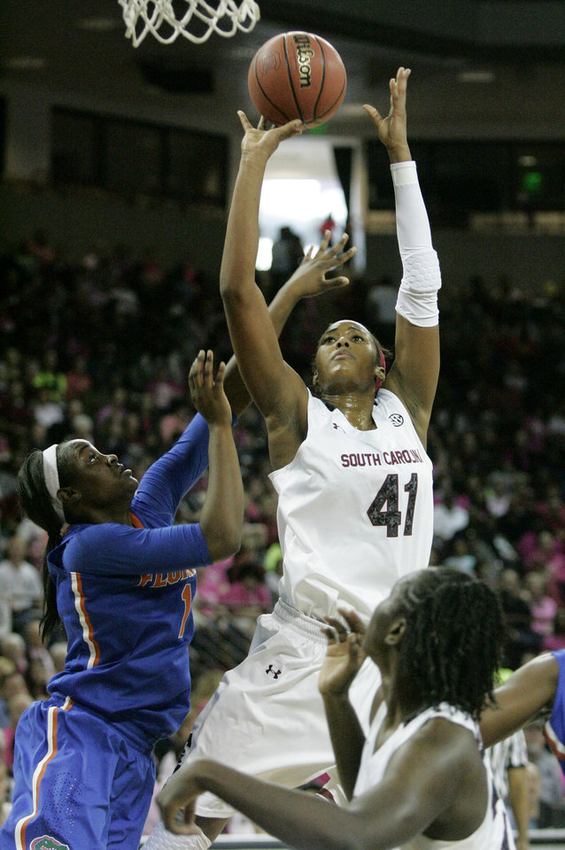 Photo - South Carolina's Alaina Coates (41) drives for the basket as Florida's Jaterra Bonds (10) tries to block during the first half of their NCAA women's college basketball game, Sunday, Feb. 23, 2014, in Columbia, S.C. (AP Photo/Mary Ann Chastain)