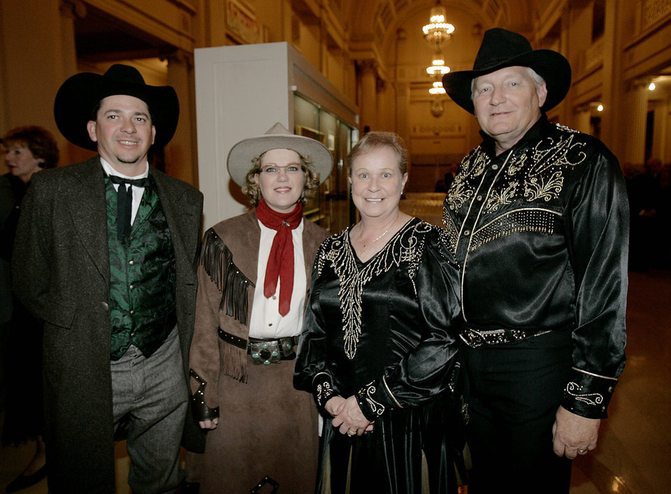 Photo - Dale and Linda Sorrell, left, of Guthrie, pose with Wanda and Ken Christensen of Arcadia, Okla., at the Oklahoma Centennial Statehood Inaugural Ball, Saturday, Nov. 17, 2007, at the Guthrie Scottish Rite Masonic Center, in Guthrie, Okla. By Bill Waugh, The Oklahoman