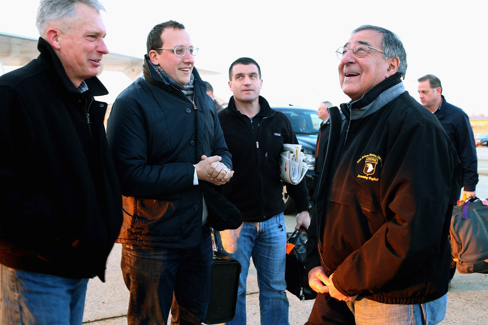 Outgoing Defense Secretary Leon Panetta, right, talks with Marine Lt. Gen. Thomas Waldhauser, left, and assistant Defense Department press secretary Carl Woog, second from left, before boarding a E-4B aircraft at Andrews Air Force Base, Md., Wednesday, Feb. 20, 2013, before traveling to Brussels for a NATO defense ministers meeting. (AP Photo/Chip Somodevilla, Pool)