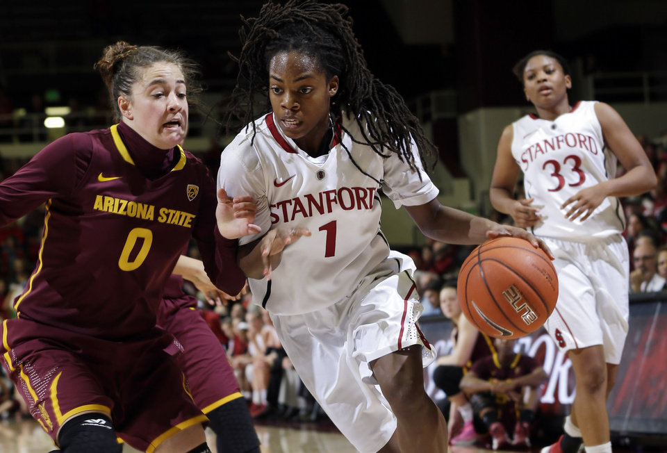 Photo - Stanford guard Lili Thompson (1) dribbles next to Arizona State guard Katie Hempen (0) during the first half of an NCAA college basketball game Friday, Feb. 14, 2014, in Stanford, Calif. (AP Photo/Marcio Jose Sanchez)