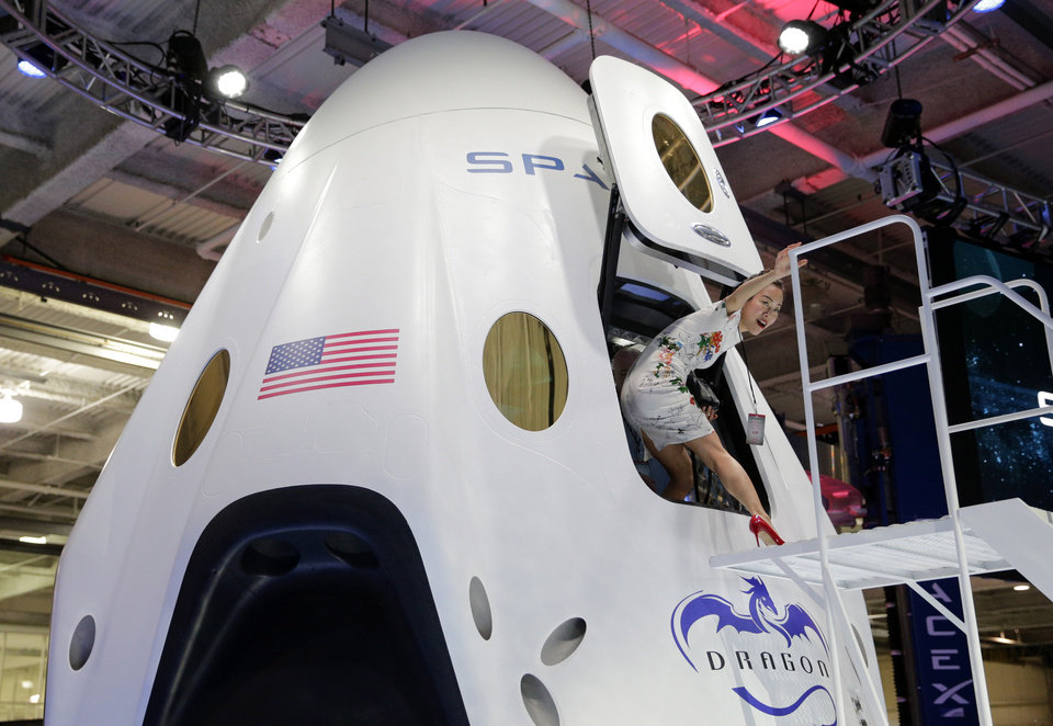 Photo -  Invited guest Robin Lee walks out of the cabin of the SpaceX Dragon V2 spacecraft Thursday at the SpaceX headquarters in Hawthorne, Calif. AP Photo   Jae C. Hong -  AP