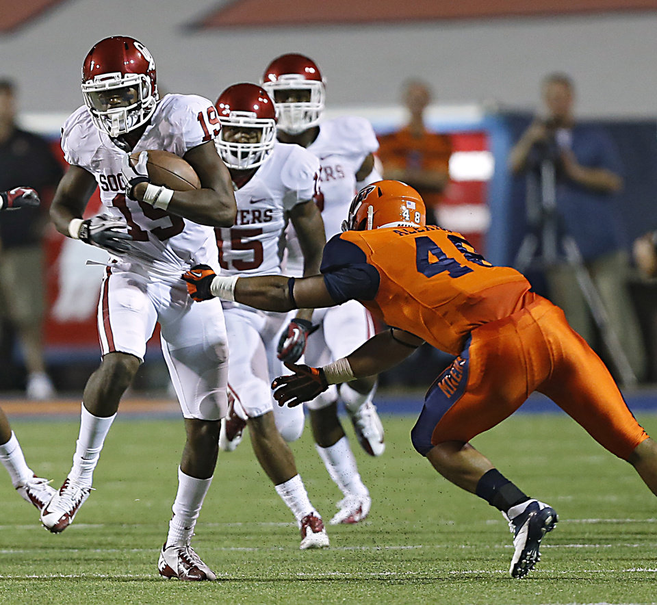 Photo - Oklahoma Sooners wide receiver Justin Brown (19) runs by UTEP's Aubrey Alexius (48) during the college football game between the University of Oklahoma Sooners (OU) and the University of Texas El Paso Miners (UTEP) at Sun Bowl Stadium on Saturday, Sept. 1, 2012, in El Paso, Tex.  Photo by Chris Landsberger, The Oklahoman