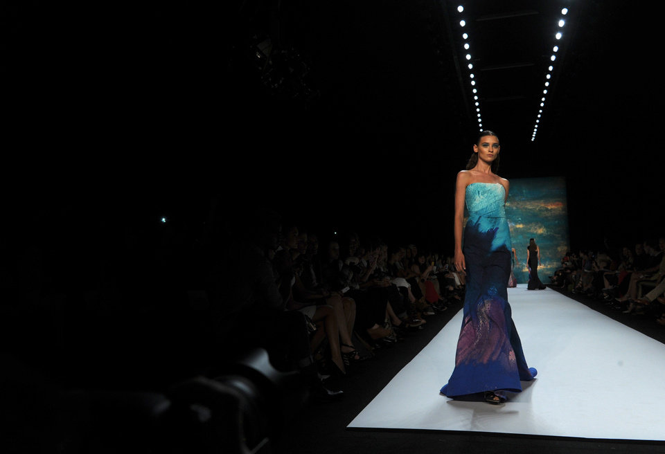 Photo -   A model walks the runway at the Monique Lhuillier spring 2013 show, Saturday, Sept. 8, 2012, during Fashion Week in New York. (AP Photo/Diane Bondareff)