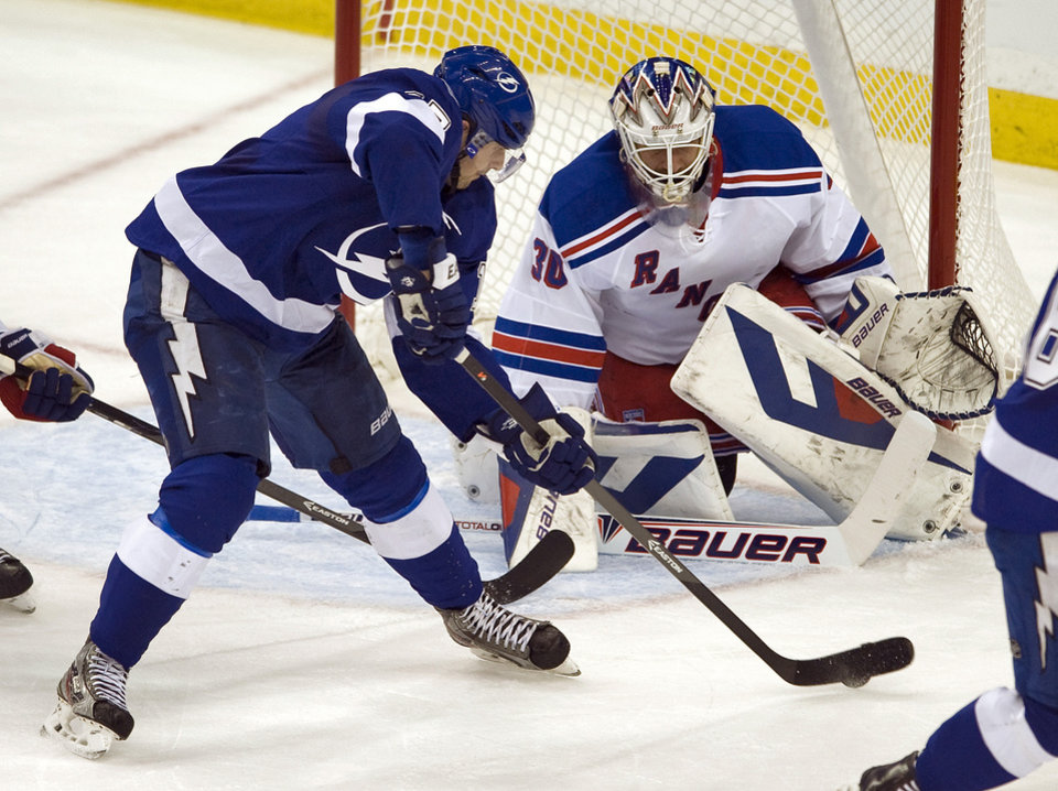 New York Rangers goalie Henrik Lundqvist (30) defends Tampa Bay Lightning's Alex Killorn, left, during the first period of an NHL hockey game, Sunday, Dec. 29, 2013, in Tampa, Fla. (AP Photo/Steve Nesius)