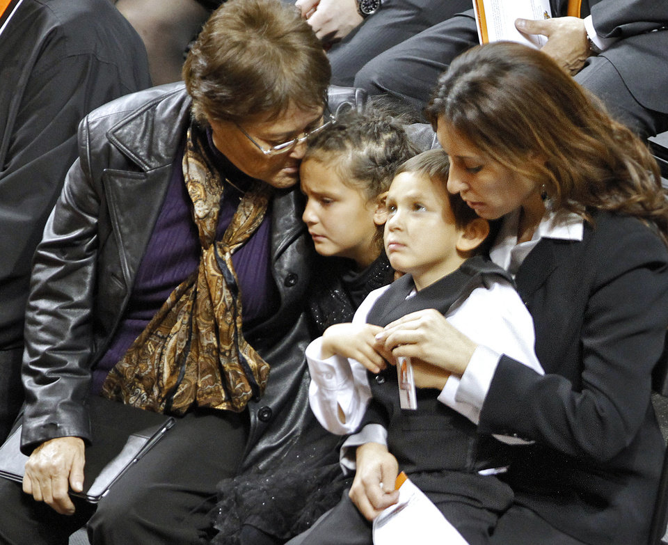 Miranda Serna's mother Nettie Herrera, left, and sister, Cassandra look on during the memorial service for Oklahoma State head basketball coach Kurt Budke and assistant coach Miranda Serna at Gallagher-Iba Arena on Monday, Nov. 21, 2011 in Stillwater, Okla. The two were killed in a plane crash along with former state senator Olin Branstetter and his wife Paula while on a recruiting trip in central Arkansas last . Photo by Chris Landsberger, The Oklahoman