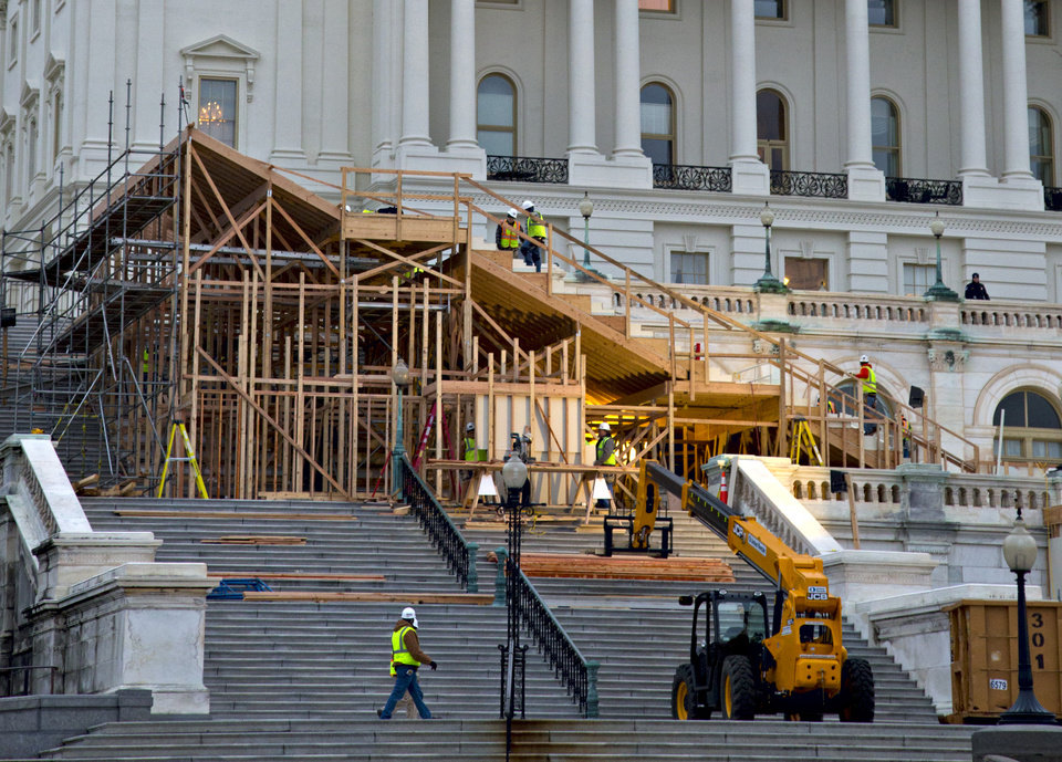 FILE - This Nov. 28, 2012 file photo shows construction contining on Capitol Hill in Washington, on the viewing stand for President Barack Obama's January's Inauguration Day ceremonies.  Four years ago, Barack Obama's swearing-in drew a jubilant record crowd to the National Mall to witness history: the country's first black president taking the oath of office. This time, the capital is pre-occupied with a looming economic crisis, exit from war and reshuffling in Congress. It's almost as if Obama's swearing in on the Martin Luther King Jr. holiday is a been-there-done-that moment.  (AP Photo/J. Scott Applewhite, File)