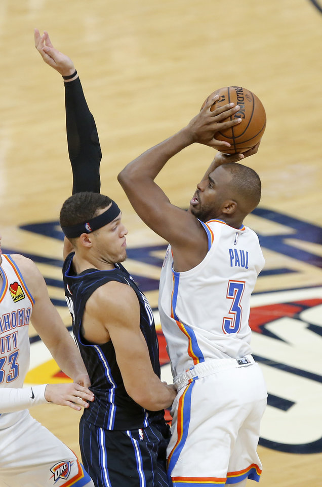 Photo - Oklahoma City's Chris Paul (3) is fouled by Orlando's Aaron Gordon (00) during an NBA basketball game between the Oklahoma City Thunder and the Orlando Magic at Chesapeake Energy Arena in Oklahoma City, Tuesday, Nov. 5, 2019. Oklahoma City won 102-94. [Bryan Terry/The Oklahoman]