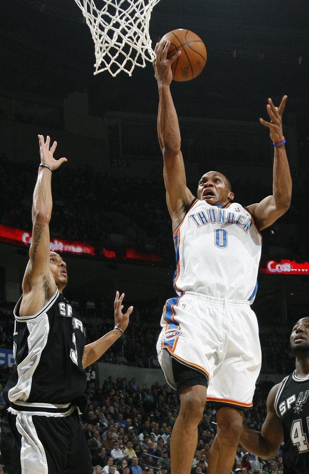 Oklahoma City's Russell Westbrook moves past San Antonio's George Hill, left, and DeJuan Blair during the NBA basketball game between the Oklahoma City Thunder and the San Antonio Spurs at the Ford Center in Oklahoma City, Wednesday, January 13, 2010. Photo by Bryan Terry, The Oklahoman