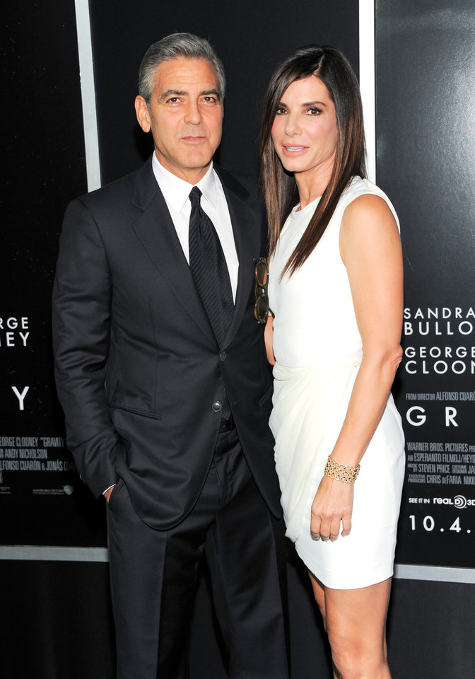 "Photo - Actors George Clooney and Sandra Bullock attend the premiere of ""Gravity"" at the AMC Lincoln Square Theaters on Tuesday, Oct. 1, 2013, in New York. (Photo by Evan Agostini/Invision/AP) ORG XMIT: NYEA110"