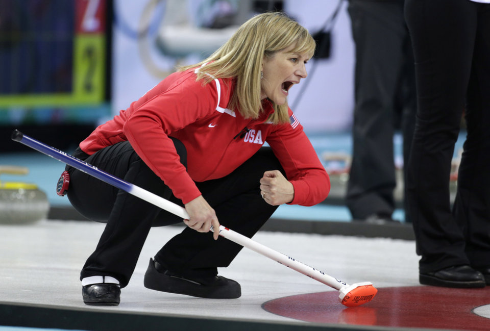 Photo - Erika Brown, skip of the United States team, shouts instructions from the house during women's curling competition against Denmark at the 2014 Winter Olympics, Friday, Feb. 14, 2014, in Sochi, Russia. (AP Photo/Robert F. Bukaty)
