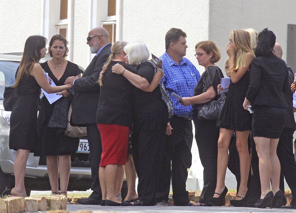 Photo - Barry Steenkamp, third left, the father of Reeva Steenkamp, greets people as he and others attend her funeral,  in Port Elizabeth, South Africa, Tuesday, Feb. 19, 2013.Olympic athlete Oscar Pistorius is charged with the premeditated murder of Reeva Steenkamp on Valentine's Day. The defense lawyer says it was an accidental shooting. (AP Photo/Schalk van Zuydam)