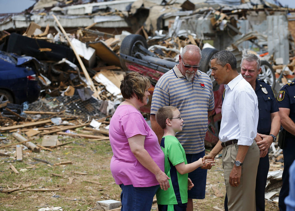 Photo -  President Barack Obama talks with Julie Lewis, her husband Scott Lewis, and their son Zack, a third-grader at Plaza Towers Elementary School, outside the destroyed school in Moore, Okla., Sunday, May 26, 2013. President Obama toured the area in Moore that was hit by a tornado on May, 20, 2013. Photo by Bryan Terry, The Oklahoman