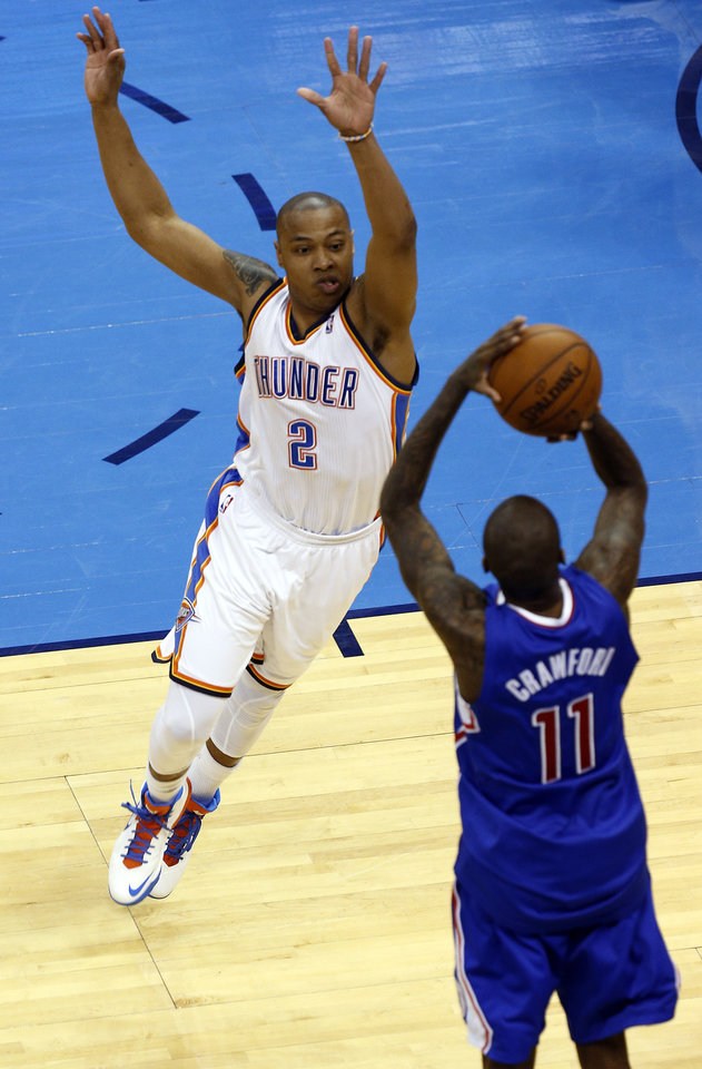 Photo - Oklahoma City's Caron Butler (2) defends against Los Angeles' Jamal Crawford (11) during Game 2 of the Western Conference semifinals in the NBA playoffs between the Oklahoma City Thunder and the Los Angeles Clippers at Chesapeake Energy Arena in Oklahoma City, Wednesday, May 7, 2014. Photo by Sarah Phipps, The Oklahoman