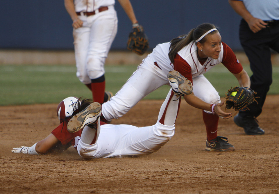 Oklahoma's Javen Henson (7) slides in past Alabama's Kaila Hunt (10) during a Women's College World Series game between OU and Alabama at ASA Hall of Fame Stadium in Oklahoma City, Monday, June 4, 2012.  Photo by Garett Fisbeck, The Oklahoman