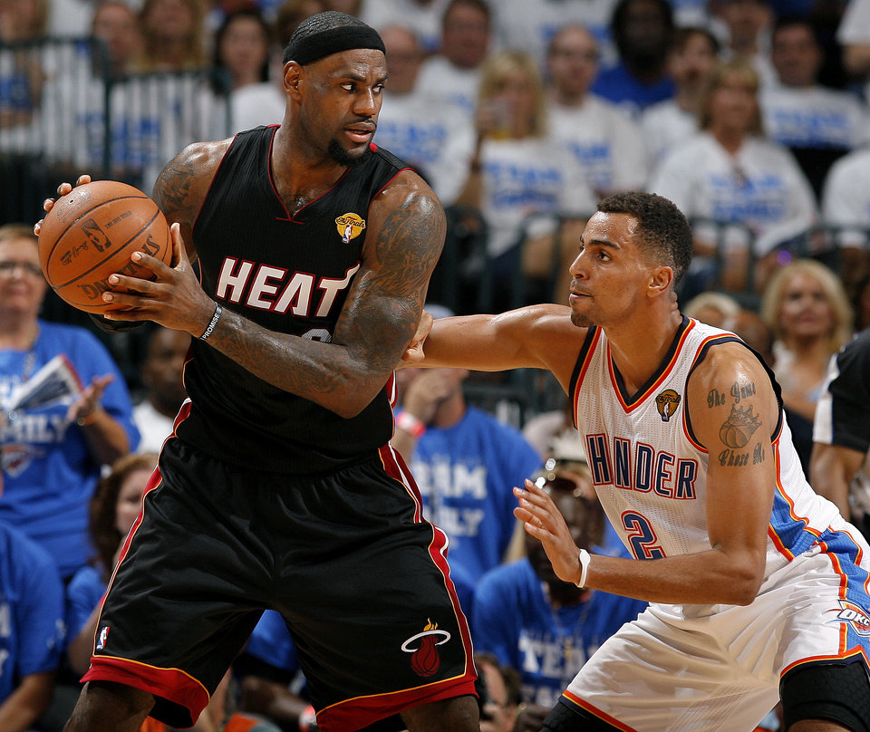 Photo - Oklahoma City's Thabo Sefolosha (2) defends Miami's LeBron James (6) during Game 2 of the NBA Finals between the Oklahoma City Thunder and the Miami Heat at Chesapeake Energy Arena in Oklahoma City, Thursday, June 14, 2012. Photo by Sarah Phipps, The Oklahoman