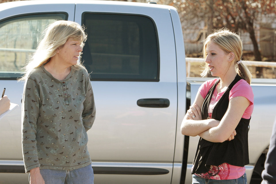 Sarah McKinley, 18, (right) talks with her mother Debbie Murray outside her rural home on Wednesday, Jan. 4, 2012, in Blanchard, Okla.  McKinley shot and killed an intruder who broke through the front door.  Photo by Steve Sisney, The Oklahoman