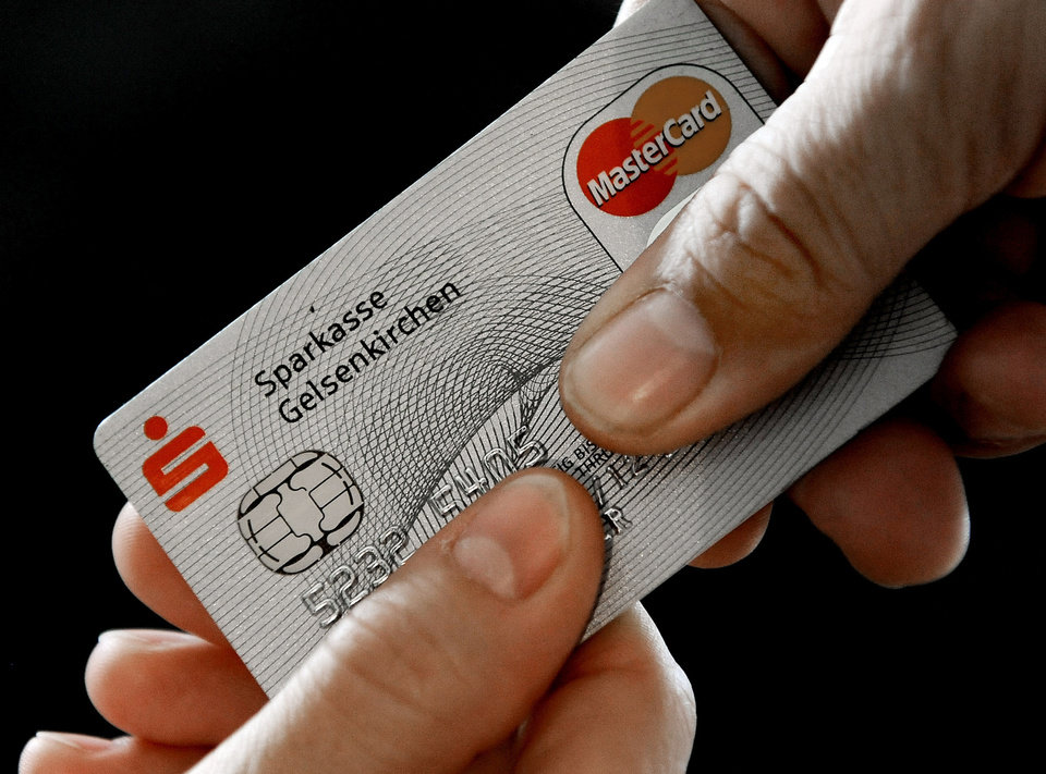 Photo - FILE - In this Nov. 18, 2009 file photo, a Mastercard chip-based credit card is posed for a photo in Gelsenkirchen, Germany. In the wake of recent high-profile data breaches, including this week's revelation that hackers stole consumer data from eBay's computer systems, Visa and MasterCard are renewing a push to speed the adoption of microchips into U.S. credit and debit cards. (AP Photo/Martin Meissner, File)