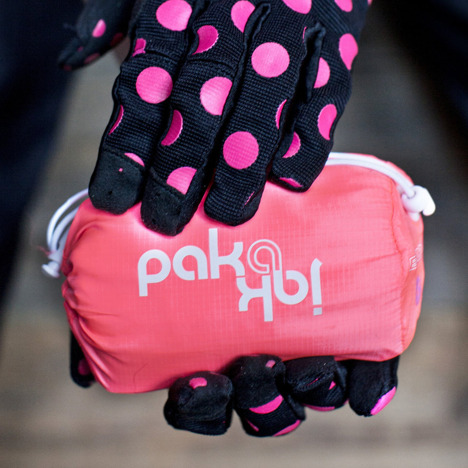 Photo - For those who use bicycles for commuting to work or errands, cycling fashion is going from spandex to multi-functional such as this packed Endura women's Pakajak jacket and gloves from Giro. (Courtney Perry/Minneapolis Star Tribune/MCT)