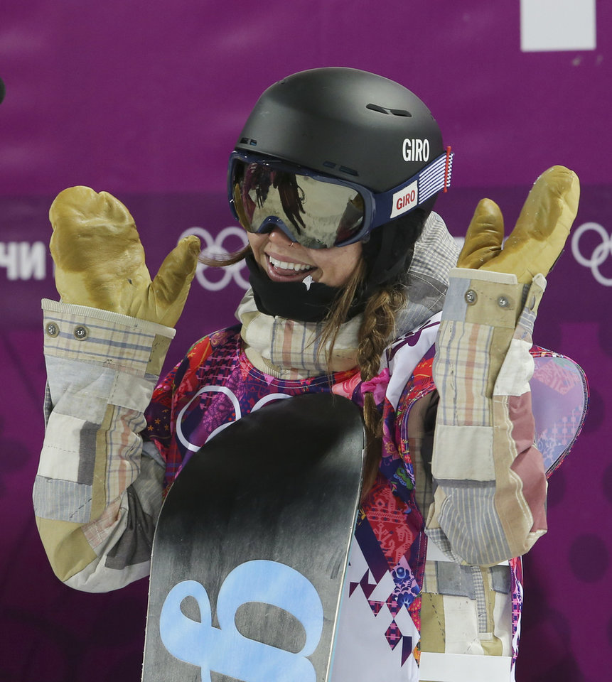 Photo - United States' Kaitlyn Farrington reacts after her second run  during the women's snowboard halfpipe final at the Rosa Khutor Extreme Park, at the 2014 Winter Olympics, Wednesday, Feb. 12, 2014, in Krasnaya Polyana, Russia. (AP Photo/Sergei Grits)
