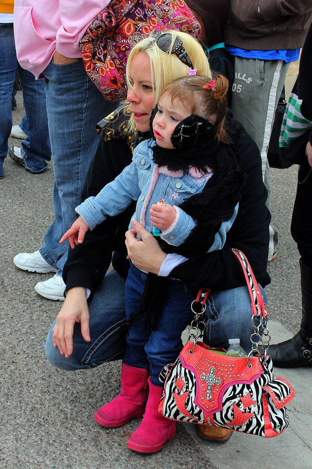 Photo - Jeanne Holmes and her daughter Karlie watch the parade during the 47th annual Czech Festival Saturday in Yukon. PHOTO BY HUGH SCOTT FOR THE OKLAHOMAN